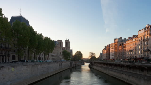 Hyperlapse Time lapse tracking shot night to day of Notre Dame in Paris