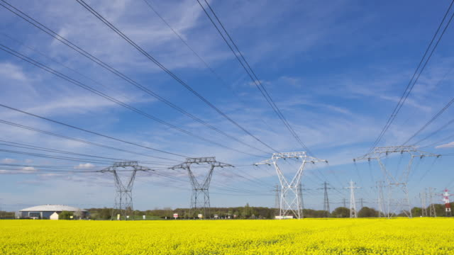 hyperlapse time lapse tracking shot of power lines and pylons - power line stock-videos und b-roll-filmmaterial