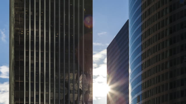Hyperlapse Time lapse tracking shot with sun reflection on office buildings