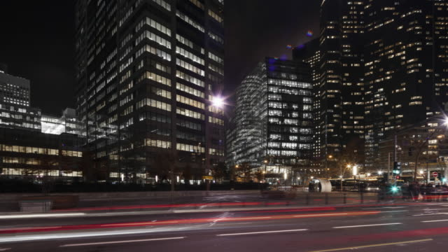 hyperlapse / time lapse with light trails at night along office buildings in business financial district paris la defense - modern stock videos & royalty-free footage