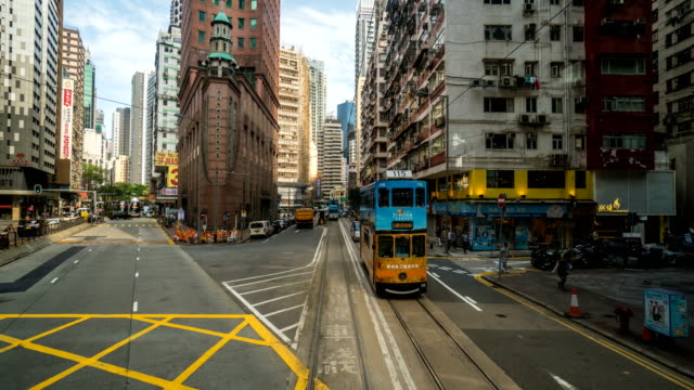 hyperlapse timelapse of hong kong from moving tram - tram stock videos & royalty-free footage