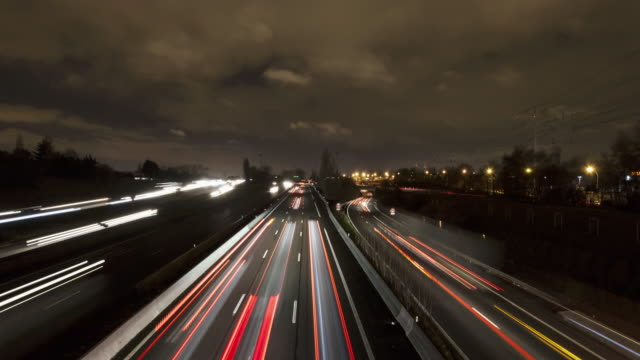 hyperlapse / tl on a bridge over a freeway - light trail stock videos & royalty-free footage