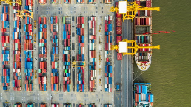 hyperlapse top view of commercial container port - digital composite stock videos & royalty-free footage