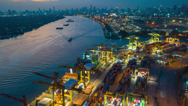 hyperlapse top view of international port with crane loading containers in import export business logistics. - pier stock videos & royalty-free footage