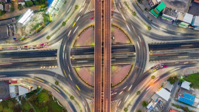 hyperlapse top view roundabout interchange of a city, expressway is an important infrastructure - complexity stock videos & royalty-free footage