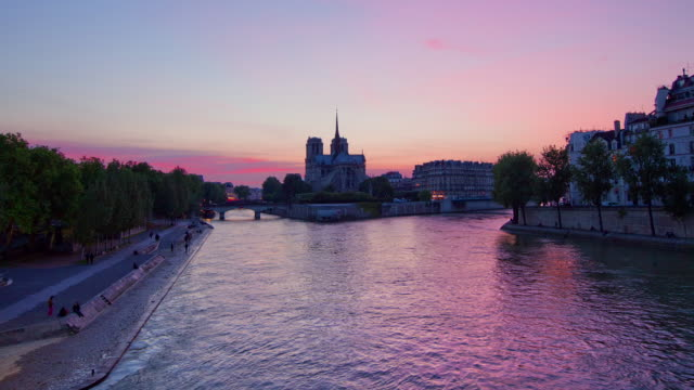 tl hyperlapse towards notre dame day to night - seine river stock videos and b-roll footage
