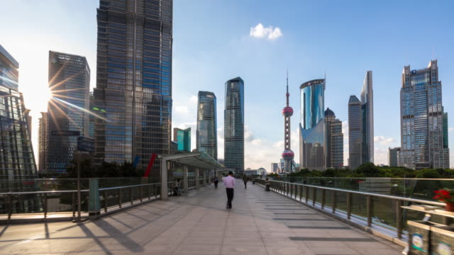 hyperlapse tracking left along elevated walkway towards pudong skyline - shanghai stock-videos und b-roll-filmmaterial