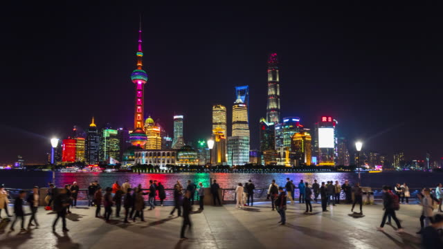 hyperlapse tracking left along the bund with pudong skyline at night - the bund stock videos & royalty-free footage