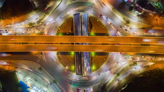 4k hyperlapse : traffic on freeway interchange - aerial view of expressway or highway road junctions - headlight stock videos & royalty-free footage
