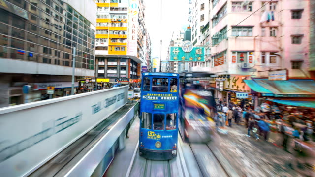 hyperlapse view moving through the streets hong kong city. - tracking shot stock videos & royalty-free footage