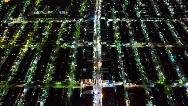 hyperlapse with tilt up of residential district or village in night time - townhouse stock videos & royalty-free footage