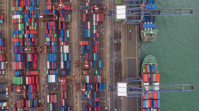hyperlapse zoom out of commercial container port in day time. - container stock videos & royalty-free footage
