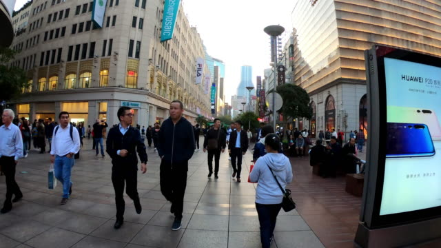hyperlaspe view of busy nanjing shopping road at shanghai.nanjing road is famous for tourism of shopping center. - nanjing stock videos & royalty-free footage