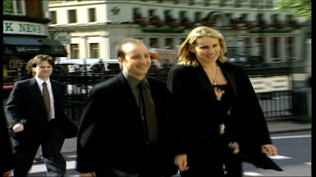 Hypnotist Paul McKenna wins libel case TX August 1998 London High Court EXT Paul Mckenna towards court with manager Clare Staples at earlier High...