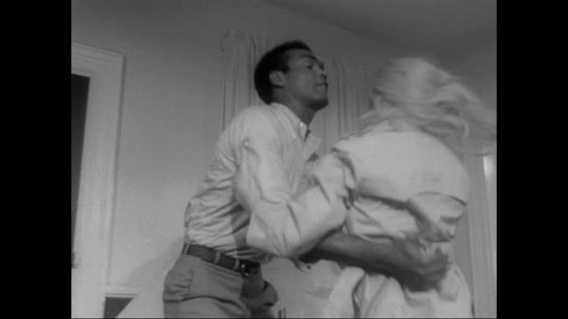 1968 Hysterical woman slaps a man, who frustratingly slaps her back before she faints