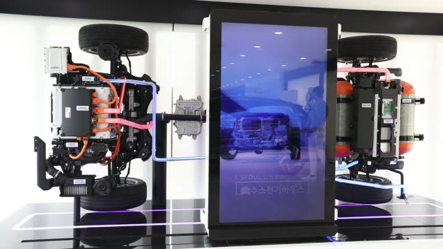 A Hyundai Motor Co next generation fuelcell electric sport utility vehicle powertrain system stands on display during an unveiling event in Seoul...