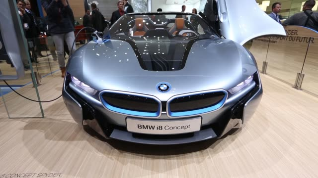 a bmw i8 concept automobile a convertible hybrid sports car produced by bayerische motoren werke ag stands on display on the first day of the 83rd... - charging sports stock videos & royalty-free footage