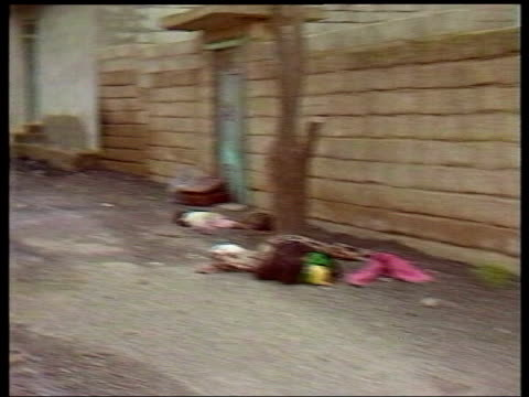 Iain Duncan Smith support for USA LIB 1988 Halabja Bodies in street TRACK FORWARD past boarded up shops Destroyed building Wreckage of vehicle...