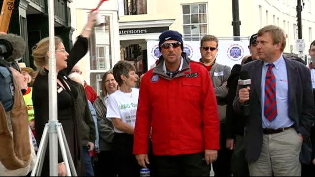 Ian Botham charity walk and interview ENGLAND Somerset Taunton EXT Crowd countdown as Ian Botham begins charity walk/ Ian Botham along with others on...
