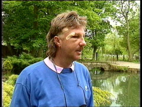 ENGLAND Yorkshire Ravensworth Ian Botham walking round his trout lake Feeds fish Ian Botham interview SOT Watching test on tv