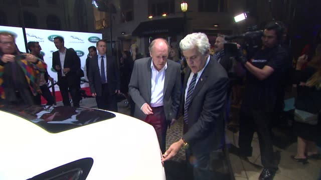 ian callum, jay leno at the jaguar land rover unveil of the new xkr-s convertible at beverly hills ca. - tv司会 ジェイ・レノ点の映像素材/bロール