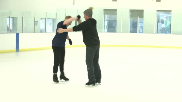 ian h watkins and matt evers in training as dancing on ice fist same sex couple - ice skating stock videos & royalty-free footage