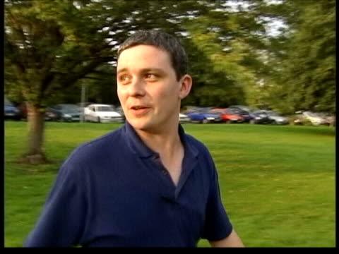 ian huntley attacked in prison; lib cambridgeshire: soham: slow motion huntley & then girlfriend maxine carr along to town meeting - itv weekend late news点の映像素材/bロール