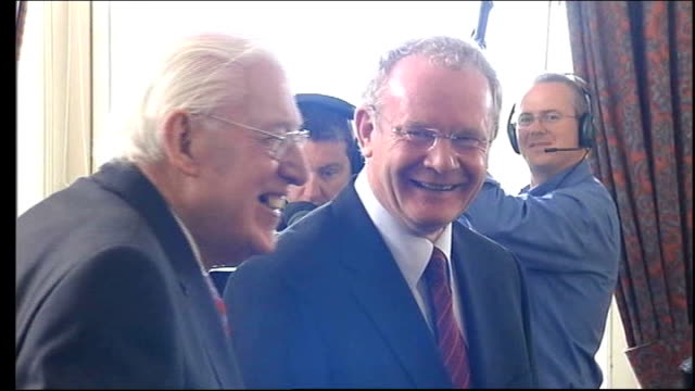 ian paisley dies aged 88 lib stormont paisley and martin mcguinness arriving in room paisley and mcguiness chatting paisley and mcguiness lauging /... - イアン ペイズリー シニア点の映像素材/bロール