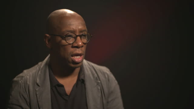 ian wright saying arsene wenger taught him 'a whole different way of thinking about playing football' - ian wright stock videos and b-roll footage
