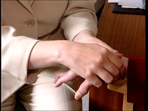 heart attack risk; file / tx 25.1.05 location unknown: cms & doctor examining arthritic hands of elderly female patient - patientin stock-videos und b-roll-filmmaterial