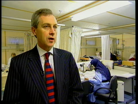 vídeos de stock e filmes b-roll de i/c busy ward to bv patient on trolley keith ford interview sot - our health authority has funded an extra 60 beds over last 18 months/ by doing that... - 12 15 meses