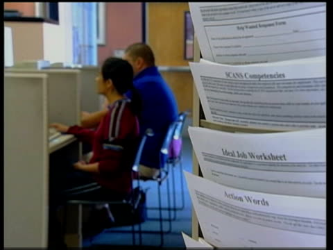 i/c gv exterior of verdugo jobs center tilt down to entrance int bv woman taking form to counter ms side people using computers pan bv man at counter... - governor stock videos & royalty-free footage