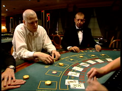 i/c in studio CS Slot machine BV Woman playing slot machine CS Croupier dealing cards TILT UP CS Gambling chips as croupier deals cards in b/g CBV...