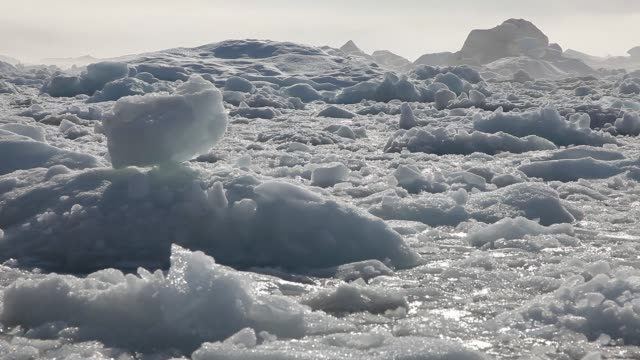 ice and icebergs flaoting on water, moving in different directions - loss stock videos and b-roll footage