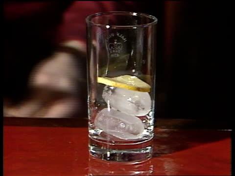 CU Ice and lemon into glass CS Optics as drink poured