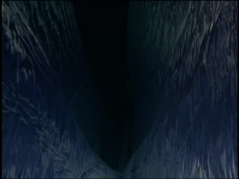 ice and rock line a crevice of a moon. - crevice stock videos & royalty-free footage