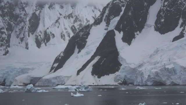 Ice and rocks long the Lemaire channel in Antarctica