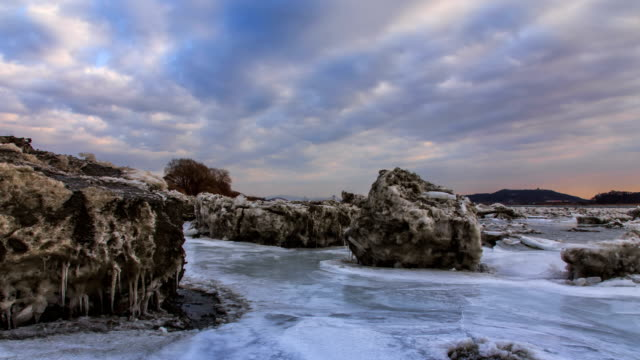 ice and snow next to gimpo bridge (connecting the cities of gimpo and goyang) during sunset - dramatic sky stock videos & royalty-free footage