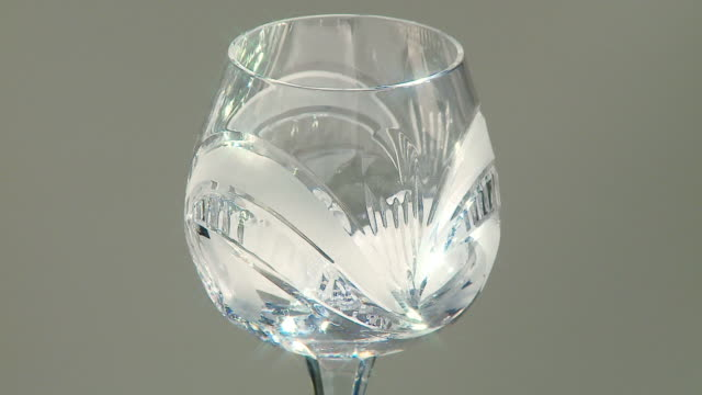 ice and whiskey into glass full hd 24fps - brandy snifter stock videos and b-roll footage