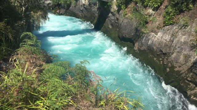 ice blue waikato river at huka falls - canyon stock-videos und b-roll-filmmaterial