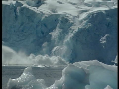 wa ice breaking off iceberg, crashing into sea, edited sequence, antarctica - antarctica iceberg stock videos & royalty-free footage
