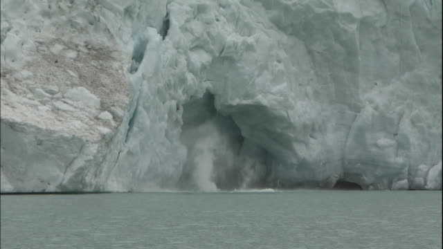 ice calving from berg glacier into berg lake, canadian rocky mountains park, canada - berg stock videos & royalty-free footage