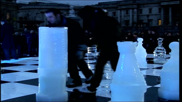 ice chess match in london and moscow dawn people moving giant ice pieces on board giant chess board with chess piece melting in foreground television... - chess piece stock videos & royalty-free footage