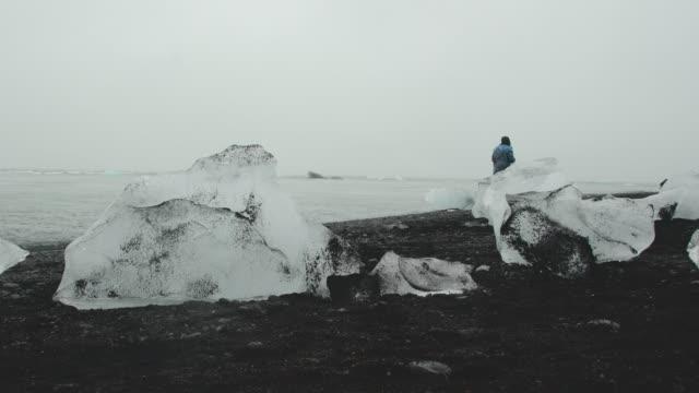 ice chunks lying on the diamond beach near the jökulsárlón lagoon - lagoon stock videos & royalty-free footage