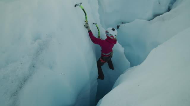 ice climber ascending narrow crevice on glacier using hooks / palmer, alaska, united states - crevice stock videos & royalty-free footage