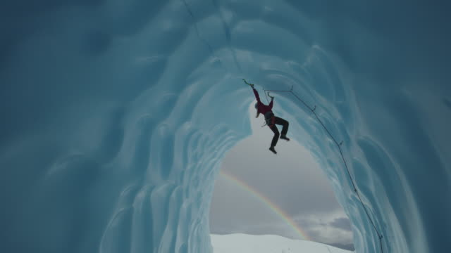 vidéos et rushes de ice climber hanging and swinging while climbing in glacier tunnel near rainbow / palmer, alaska, united states - au loin