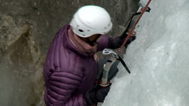 hd close-up: ice climber - sports helmet stock videos and b-roll footage