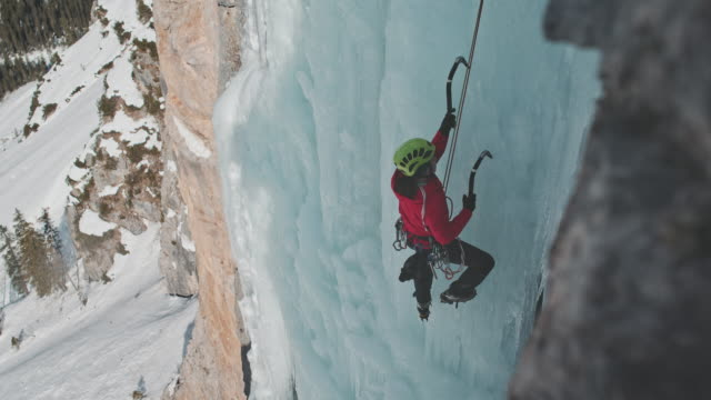 ice climbing on waterfall - climbing stock videos & royalty-free footage