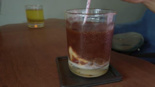 ice coffee and condensed milk in vietnam - condensed milk stock videos & royalty-free footage