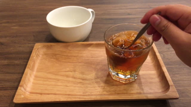 ice coffee on wooden tray, stir and drink - coffee drink stock videos & royalty-free footage